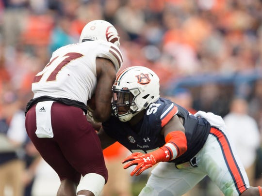 Auburn linebacker Deshaun Davis (57) tackles Louisiana Monroe running back Derrick Gore (27) during the NCAA football game between Auburn and Louisiana Monroe on Saturday, Nov. 18, 2017, in Auburn, Ala.