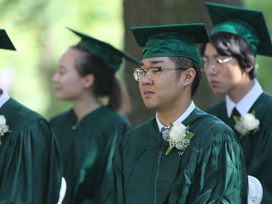 Tian Jiao on the stage during the graduation ceremony at Rockland Country Day School in Congers on Friday, June 15, 2018.