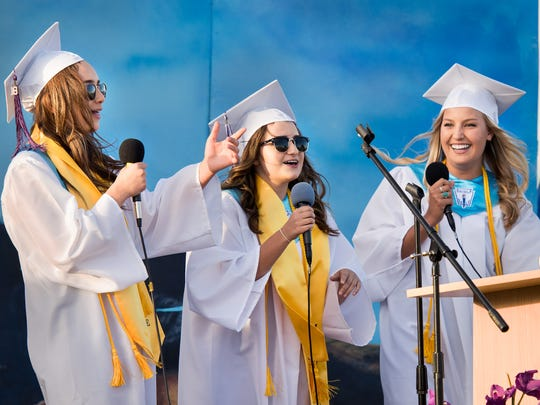 Seniors Christina Hegstad, Jennifer Ramirez and Rachel Dane perform a rap song for the crowd.