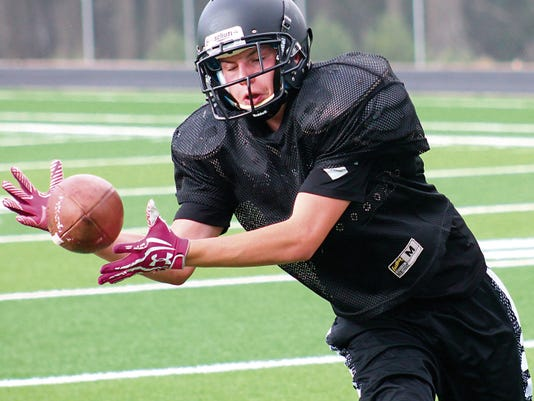 Dakota Derrick catches a pass Wednesday afternoon during practice at the Cloudcroft Athletic Field.