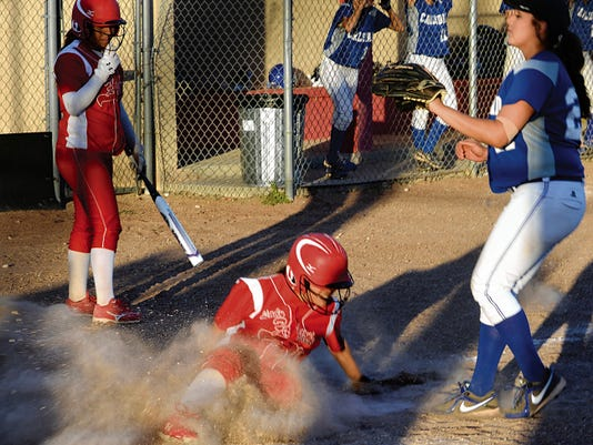 Matt Hollinshead — Current-Argus Loving sophomore pitcher Leliana Rodriguez scores a run in the bottom of the first inning of game two Tuesday against Carlsbad JV.
