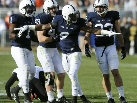 Penn State's Jordan Lucas (9) celebrates after a tackle a 2013 game at Beaver Stadium in State College. Lucas moves from cornerback to safety for the 2015 season.
