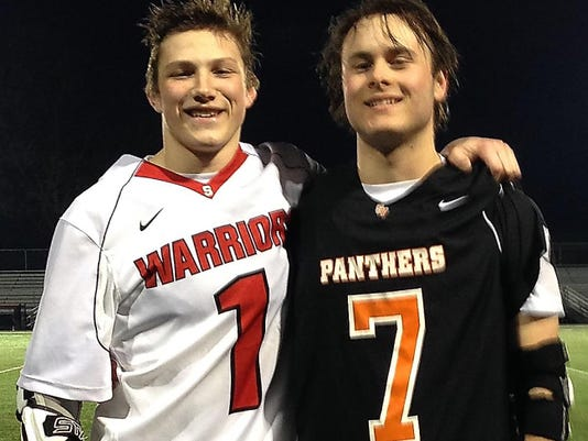 Susquehannock's Collin Riley, left, poses with Central York's Katon Yantek after Tuesday night's game. Riley's Warriors beat Yantek's Panthers, 15-7.