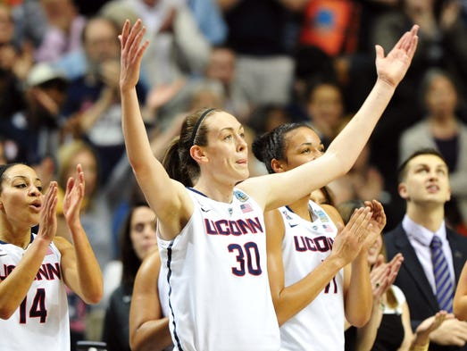 Breanna Stewart (30) leads the celebration after Connecticut defeated Stanford to advance to the national championship game.