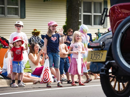 Waves, smiles and the hope of flying candy kept the young parade watchers on their toes during the Church of St. Joseph Parish Festival parade Tuesday, July 4, in St. Joseph.