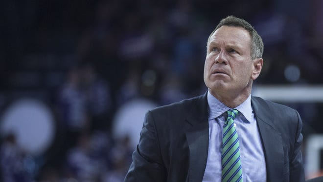 GCU head coach Dan Majerle looks up at the scoreboard after his team completes a run to tie the game in the second half against JSU at GCU in Phoenix, Ariz. on Thursday, March 17, 2016.