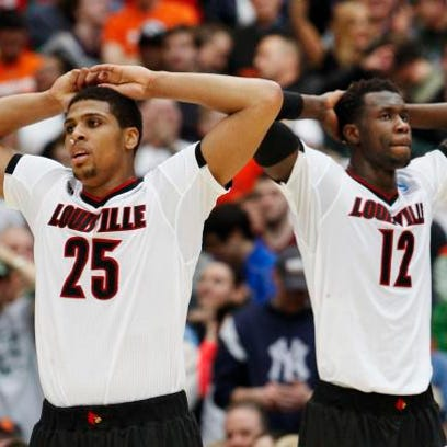 U of L's Wayne Blackshear, #25, left, and Mangok Mathiang,
