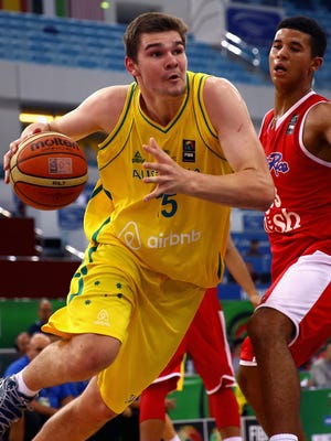 Isaac Humphries of Australia drives against Nick Berry of Puerto Rico during the FIBA U17 World Championships on August 14, 2014 in Dubai, United Arab Emirates.