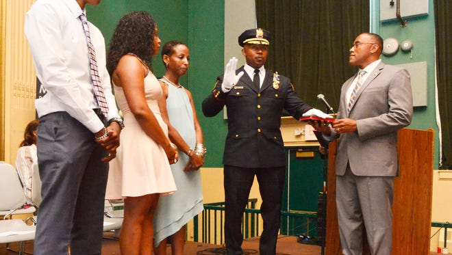 Deputy Chief of Police Wilhelm B. Young takes his oath of office during a swearing-in ceremony last June. Young will receive an award from the Montclair  High School Civics and Government Institute on Feb. 23.