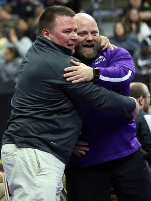 In this file photo Burlington High School's Head Coach Jay Huff and Alex Sherwood embrace after Spencer Sherwood won by decision over Tyrell Gordon (Dec 5-2) during the 3rd place wrestling match Saturday, Feb. 18, 2017  at the Iowa High School Athletics Association 2017 State Wrestling Championships in Des Moines, IA. BHS, was formally approved Monday night by the Burlington School Board as the next activities director at BHS.