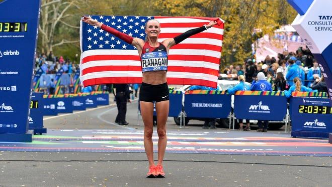 Shalane Flanagan celebrates after winning the professional women's division at the 2017 TCS New York City Marathon.