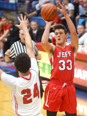 Lafayette Jeff's Keaton Schreckengast puts up a shot in the first quarter.