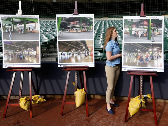 Jacque Lefeber, a manager of special events, adjusts