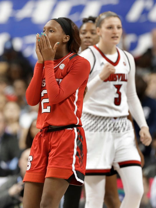 North Carolina State's Kaila Ealey (2) reacts after being called for a foul against Louisville's Sam Fuehring (3) during the second half of an NCAA college basketball game in the semifinals of the women's Atlantic Coast Conference tournament in Greensboro, N.C., Saturday, March 3, 2018. Louisville won 64-59. (AP Photo/Chuck Burton)