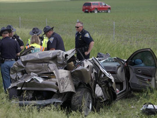 Authorities at the scene of a June 2014 crash on Interstate 69 in southwestern Delaware County that claimed the life of a 4-year-old girl.