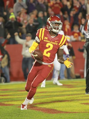 Oct 17, 2015; Ames, IA, USA; Iowa State Cyclones running back Mike Warren (2) scores a tochdown in the second quarter against the TCU Horned Frogs at Jack Trice Stadium. Mandatory Credit: Reese Strickland-USA TODAY Sports