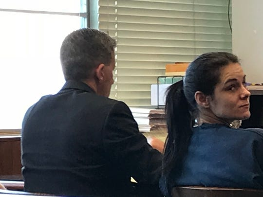 Fred Sanderson, left, and Johanna Knighten are shown during their preliminary hearing in January. Attorney Josh Lowery, who represented Sanderson, is at center.
