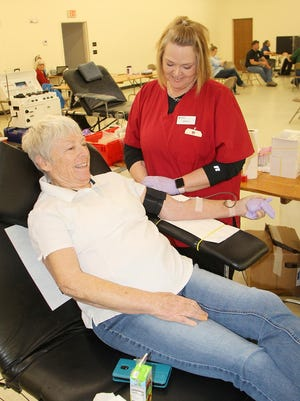 Red Cross phlebotomist Julie Johnson prepares blood donor Karen Lemon for her donation at a blood drive on March 19 in Pratt. Many blood drives across America have been canceled so every pint is more important than ever.