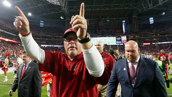 Arizona Cardinals coach Bruce Arians gestures to fans following a Cardinals home game. Arians, a former York County resident, has been head coach of the Cardinals the past four years.