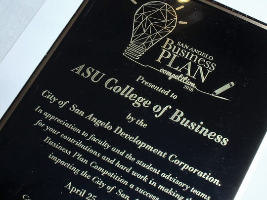 The ASU College of Business was presented a plaque