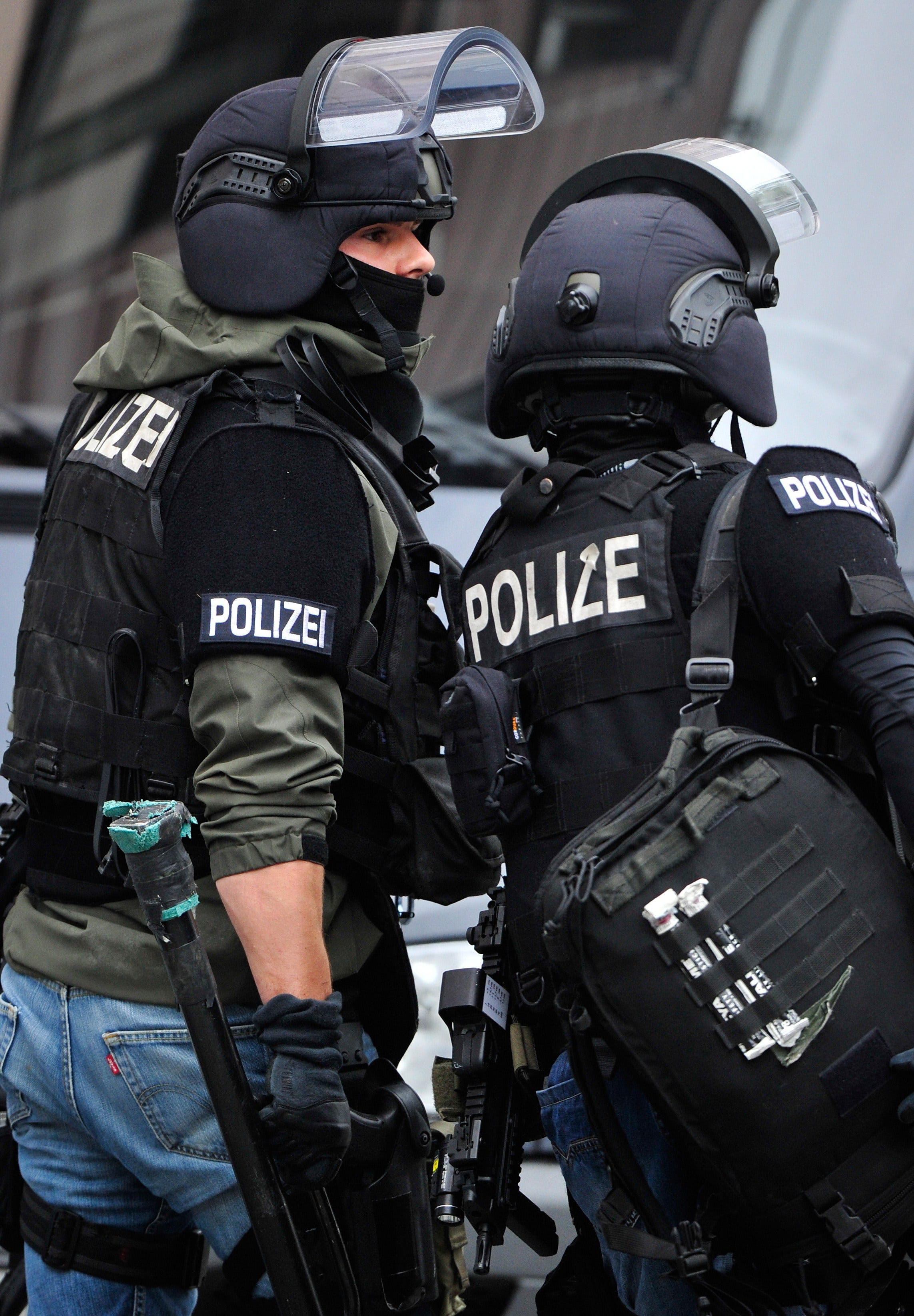German special police forces leave the scene of a hostage taking in the town hall in Ingolstadt, Germany, on August 19, 2013.