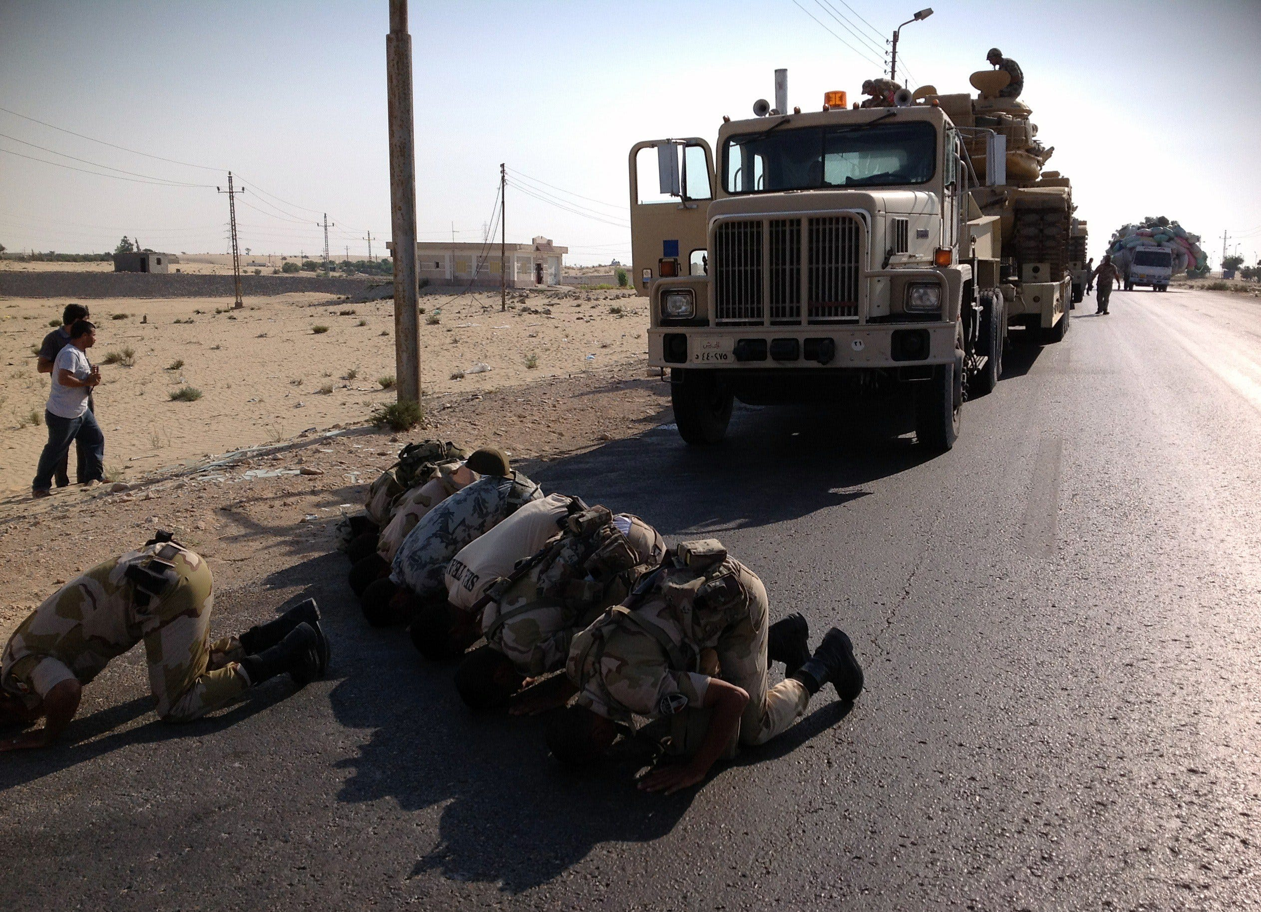 A picture taken on July 16 shows Egyptian soldiers praying as they are deployed in the northern Sinai town of Al-Arish.