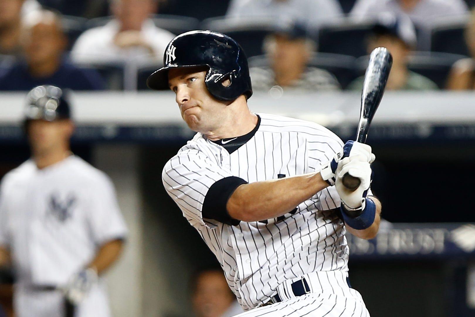 New York Yankees third baseman Jayson Nix singles in the game winning RBI against the Toronto Blue Jays during the ninth inning at Yankee Stadium.