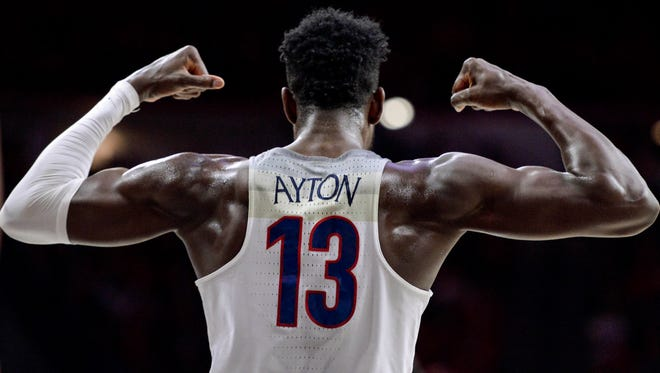 Arizona Wildcats forward Deandre Ayton (13) flexes during the second half against the Stanford Cardinal at McKale Center.