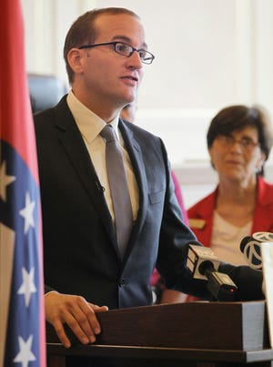 In this June 11, 2012 photo, Human Rights Campaign President Chad Griffin, left, speaks at a news conference in Little Rock, Ark. Then-state Rep. Kathy Webb, a Little Rock Democrat, is at right.