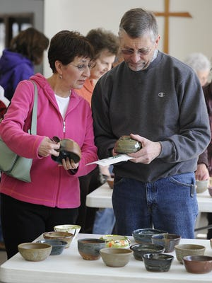 Guadalupe and Joe Ancel at the South Wood County Empty Bowls event in 2014.