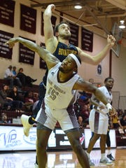 Howard Payne's Cole Bene goes over the back of McMurry's