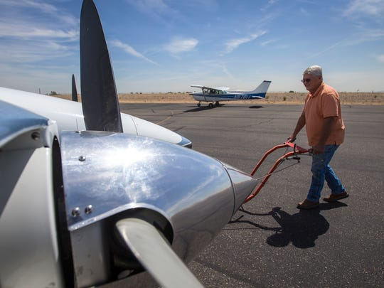 Richard Goldman uses a tugger to move his plane back into his hanger at the Glendale Municipal Airport, on Friday, April 25, 2014. He and a group of pilots, who own their 2000 square-foot hangers there, sued the city for enforcing rules on non-aviation contents in their hangars. Goldman stores a couple of bicycles, motorcycle, some tools and a weight bench that do not comply with the rules.