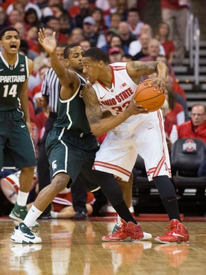 Ohio State Buckeyes guard Lenzelle Smith Jr. (32) looks for a way around Michigan State Spartans guard Keith Appling (11) at the Schottenstein Center.