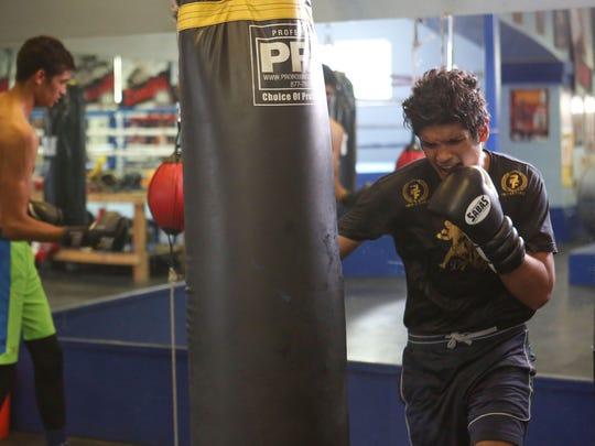 Alberto, right, and Sebastian Fundora train at the Coachella Valley Boxing Club.