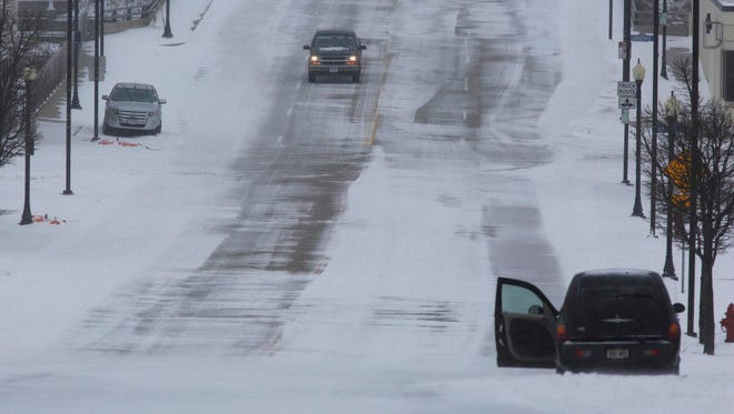 Snow covers Pennsylvania Avenue, Sunday, April 15, 2018 in Sheboygan, Wis.