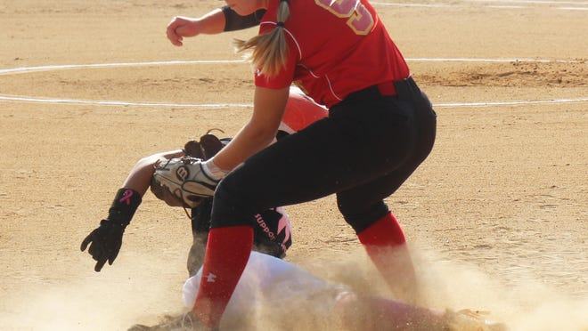 La Junta High School's Chantel Martinez is tagged out by Rocky Ford's Baylie Krueger in Saturday's game at Tippy Martinez Park. Both teams have advanced to the state tournament. La Junta travels to Fort Lupton while Rocky will host Brush.