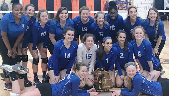 Livonia Ladywood celebrates after winning the Class B regional volleyball title against Carleton Airport.