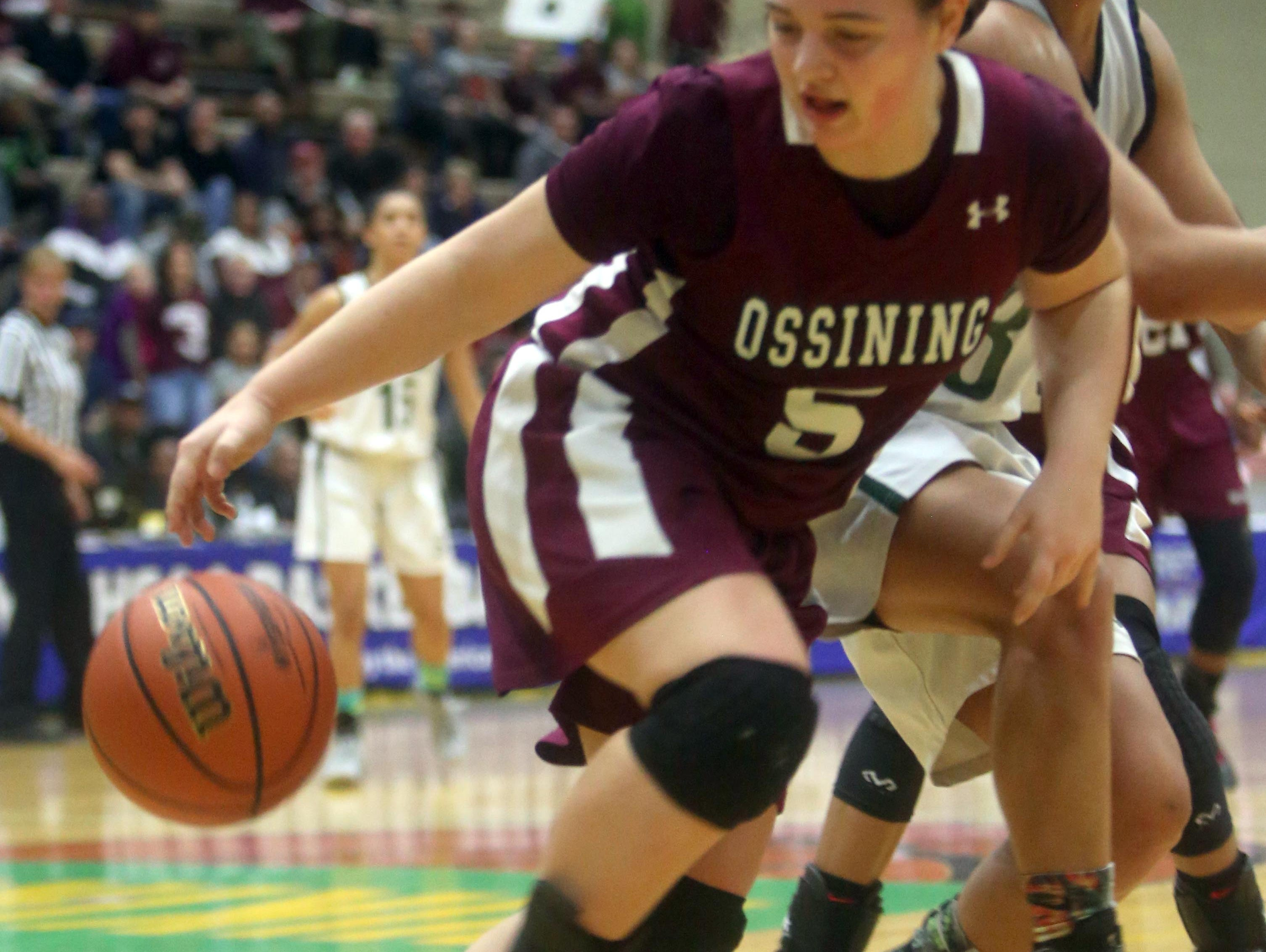 Ossining's Kelsey Quain grabs a rebound during the New York State Class AA championship at Hudson Valley Community College in Troy March 12, 2016.