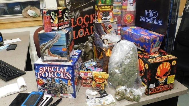 Fireworks and drugs police say they confiscated from a Quincy man arrested in Boston.