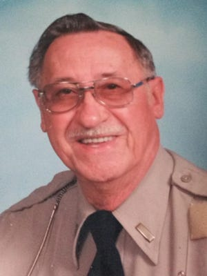 In this undated photo, Melvin Kuehn poses in his uniform for the Peoria County Sheriff's Office auxiliary unit.