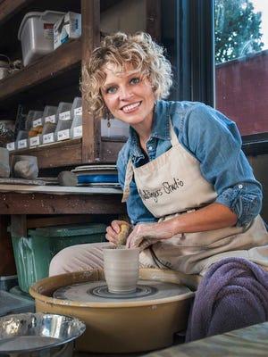 Lori Neal Nolen is pictured at work at Mudslinger's Studio
