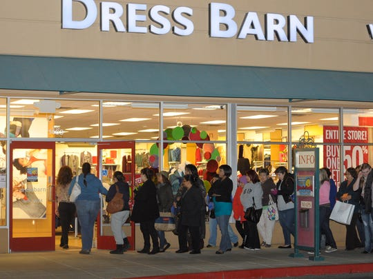 Shoppers wait in line for the opening of stores at the Tulare Outlet Center during Black Friday on Thursday night in 2012.