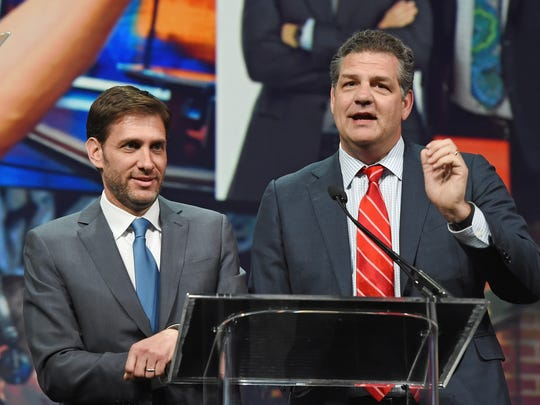 Sports broadcasters Mike Greenberg (left) and Mike