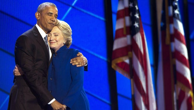 President Barack Obama embraces Hillary Clinton onstage after speaking at the Democratic National Convention in Philadelphia.