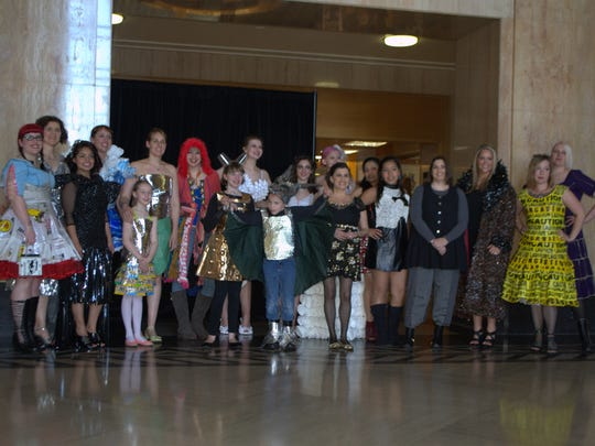 """Participants of Upcycle Oregon's 2015 """"trashion"""" show pose for a group photo. Upcycle Oregon is a free event promoting creative reuse through art, fashion and hands-on learning experiences 10 a.m. to 5 p.m. May 21 at Salem Convention Center."""