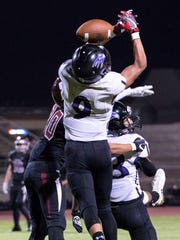 Mission Oak's Zach Wilson leaps for a pass against Mt. Whitney in a non-league high school football game on Friday, September 7, 2018.