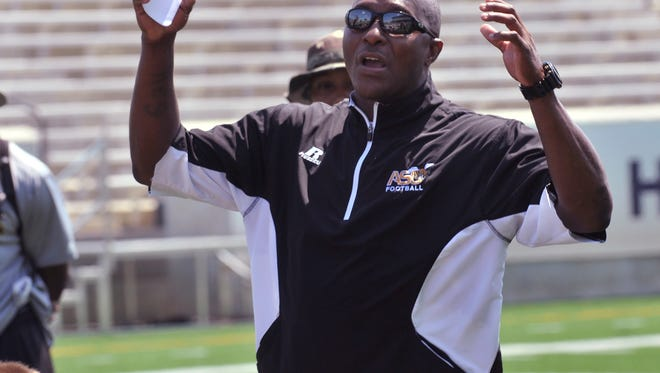 Alabama State University's Coach Reggie Barlow talks with the team after their football scrimmage on Saturday, Aug. 16, 2014.