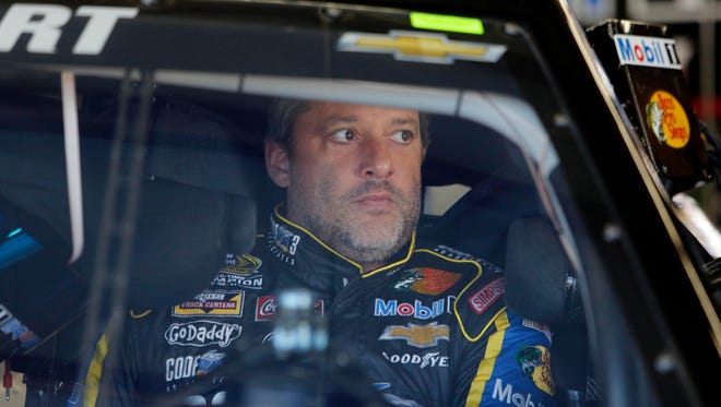 Driver Tony Stewart sits in his car during practice for the NASCAR Sprint Cup auto race at New Hampshire Motor Speedway, Friday, Sept. 19, 2014, in Loudon, N.H.