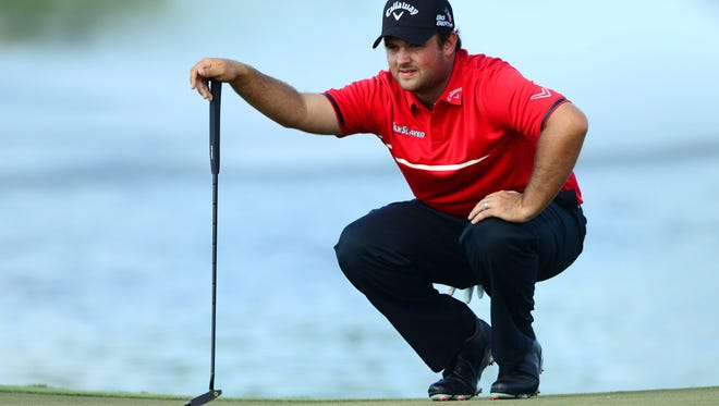 Patrick Reed  lines up a putt on the 8th green during the final round of the WGC - Cadillac Championship golf tournament Sunday. Reed won for the third time this season.