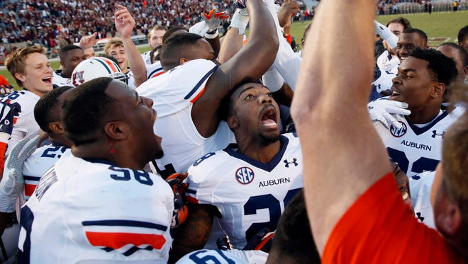 Auburn Tigers celebrate their 45-41 victory against the Texas A&M Aggies at Kyle Field.